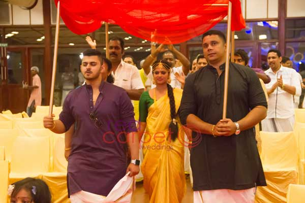 knanaya betrothal ceremony bridal entry with her brothers -Christian wedding planning by Red Carpet Events at kumarakom kottayam kerala India Wedding Planning Gallery