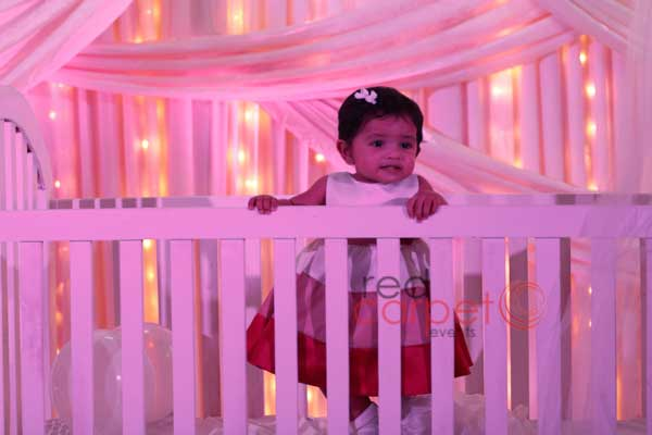 the pretty baby inside the crib -Birthdays and Baptism planning by Red Carpet Events at Hotel radisson blu kochi kerala India Wedding Planning Gallery