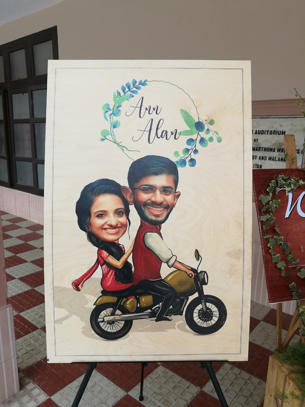Christian_wedding_parumala_Church_wedding_planner_thiruvalla_kerala_Grape_arch_entrance_decor_stage_decor_caricature_board.jpg