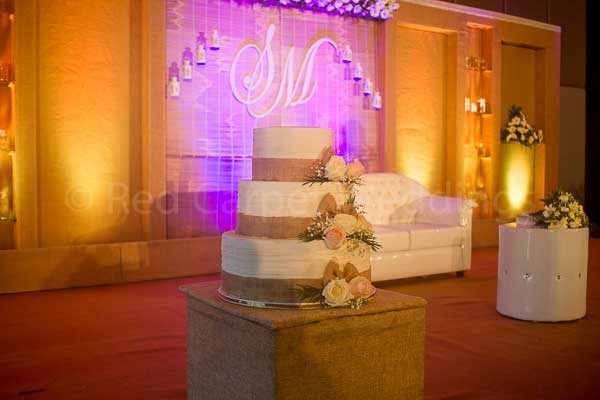 gold & white theme cake -Christian wedding planning by Red Carpet Events at hotel crowne plaza kochi kerala India Wedding Planning Gallery