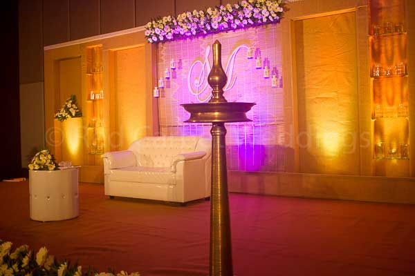 traditional lamp for lighting -Christian wedding planning by Red Carpet Events at hotel crowne plaza kochi kerala India Wedding Planning Gallery