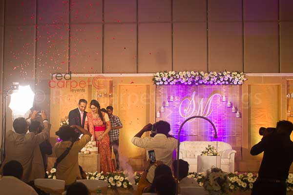 flower shower for cake cutting -Christian wedding planning by Red Carpet Events at hotel crowne plaza kochi kerala India Wedding Planning Gallery