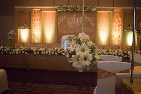 hanging floral pathway decor -Christian wedding planning by Red Carpet Events at hotel crowne plaza kochi kerala India Wedding Planning Gallery