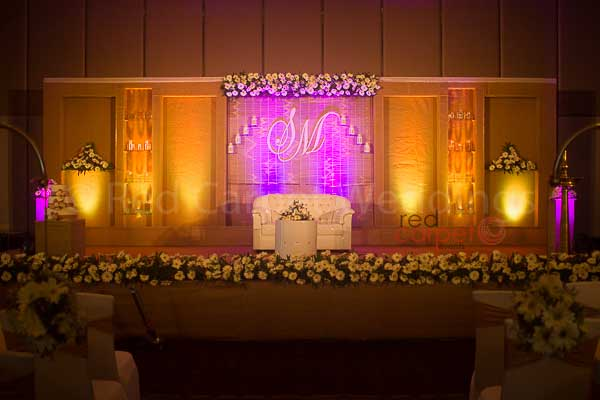 gold & off white stage decor -Christian wedding planning by Red Carpet Events at hotel crowne plaza kochi kerala India Wedding Planning Gallery