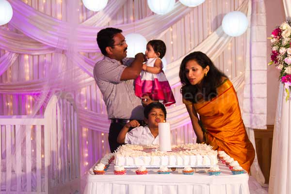 pink & white theme cake -Birthdays and Baptism planning by Red Carpet Events at hotel radisson blu kochi kerala India Wedding Planning Gallery