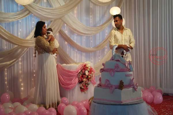 baby & mother in pink & white theme -Birthdays and Baptism planning by Red Carpet Events at pathanamthitta kerala India Wedding Planning Gallery