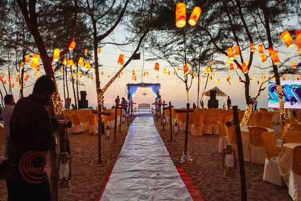 walkway with rose petals beach wedding decor