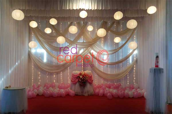 pink & white theme decor with hanging lights -Birthdays and Baptism planning by Red Carpet Events at adoor kerala India Wedding Planning Gallery