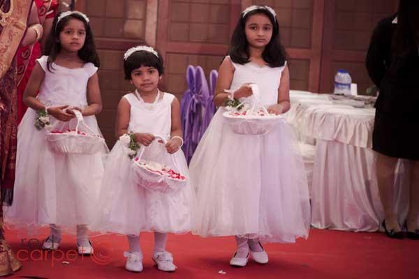 brides maid in white frock Pentecostal wedding