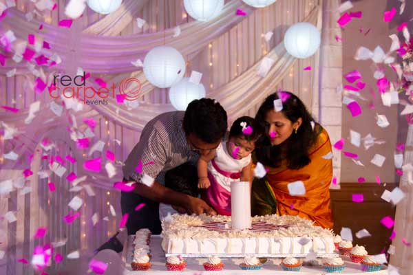 confetti blast cake cutting -Birthdays and Baptism planning by Red Carpet Events at hotel radisson blu kochi kerala India Wedding Planning Gallery