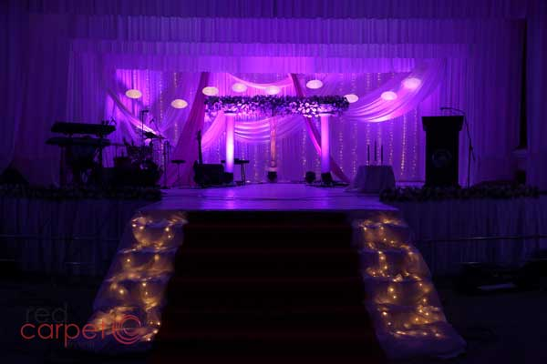 purple theme stage with illuminated entrance steps