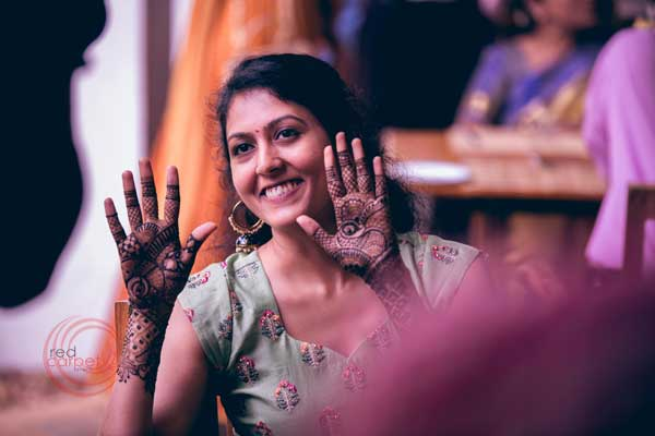 bride with mehndi on her hand -Destination wedding by Red Carpet Events at punnamada resort alappuzha kerala India Wedding Planning Gallery
