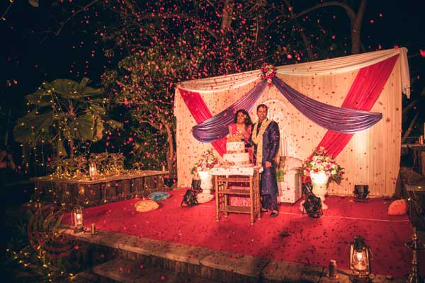 flower confetti shower for cake cutting sangeet night -Destination wedding by Red Carpet Events at punnamada resort alappuzha kerala India Wedding Planning Gallery