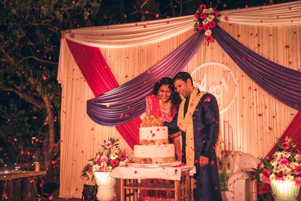 cake cutting ceremony sangeet night -Destination wedding by Red Carpet Events at punnamada resort alappuzha kerala India Wedding Planning Gallery