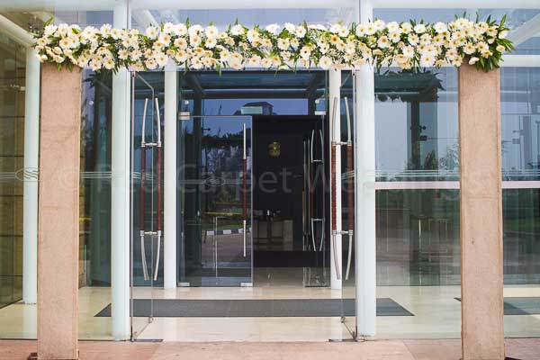 entrance arch floral & jute for betrothal -Christian wedding planning by Red Carpet Events at hotel crowne plaza kochi kerala India Wedding Planning Gallery