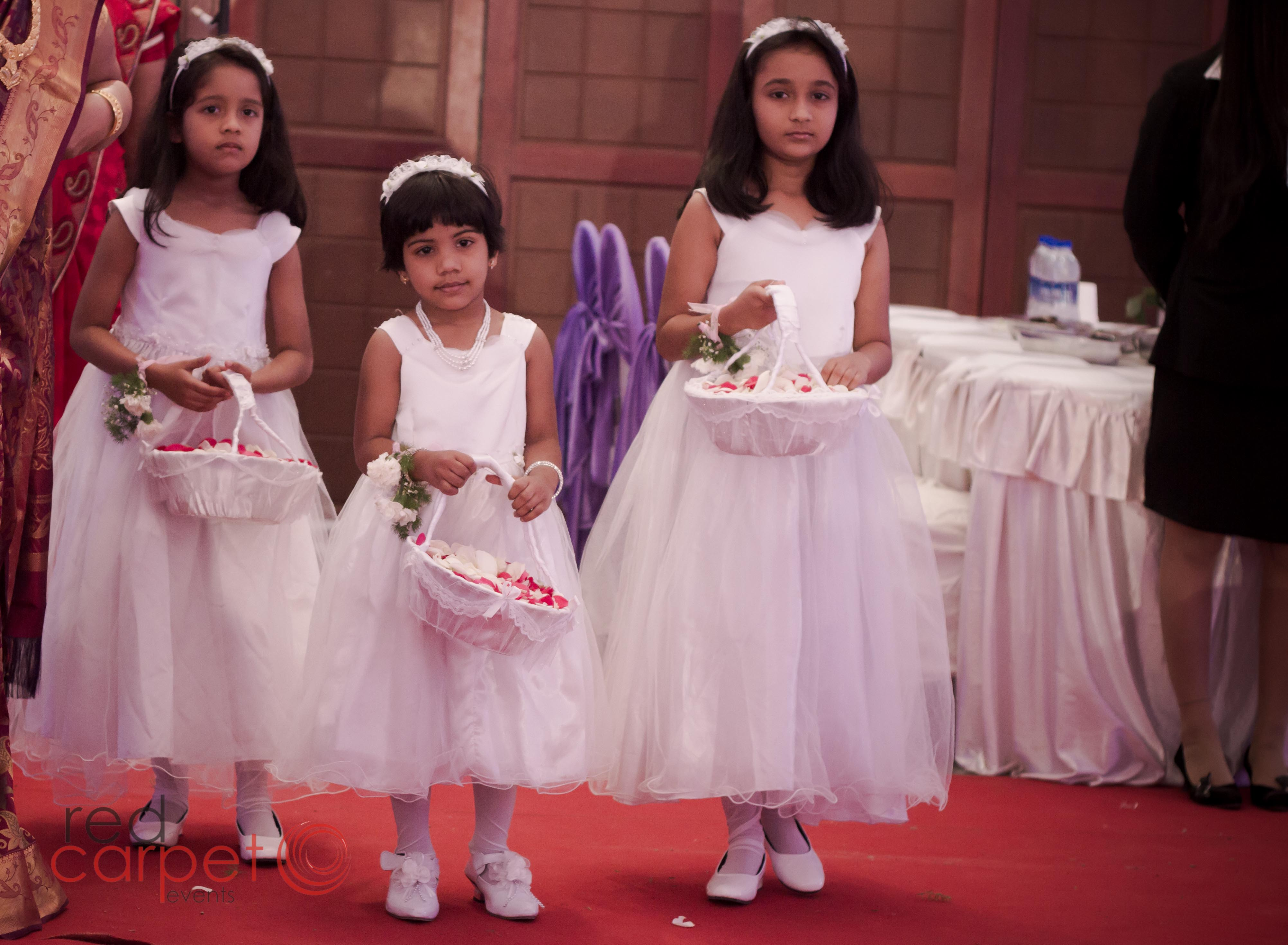 flower girls for western style christian wedding kottayam kerala india.jpg