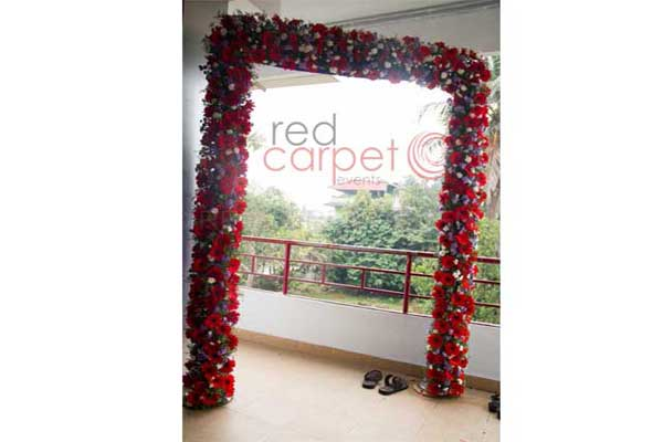 floral welcome arch -Birthdays and Baptism planning by Red Carpet Events at gokulam park inn kochi kerala India Wedding Planning Gallery