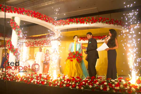 indoor cool fire work for candle lighting ceremony -Christian wedding planning by Red Carpet Events at hotel crowne plaza kochi kerala India Wedding Planning Gallery