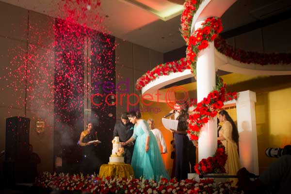 flower shower for cake cutting ceremony -Christian wedding planning by Red Carpet Events at hotel crowne plaza kochi kerala India Wedding Planning Gallery