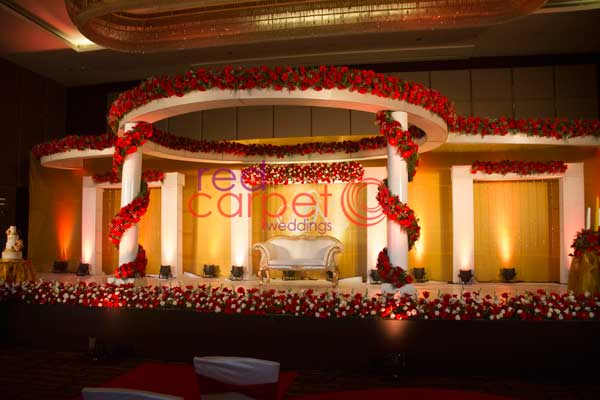 floral betrothal stage -Christian wedding planning by Red Carpet Events at hotel crowne plaza kochi kerala India Wedding Planning Gallery