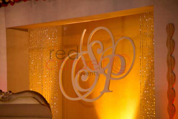 Initials logo cut out of bride & groom backdrop