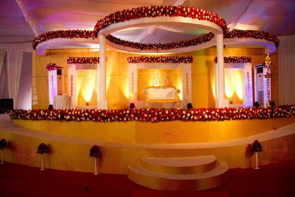 Gold theme betrothal stage with ramp