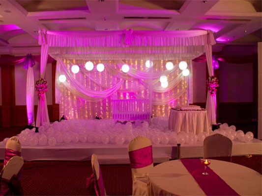 purple and white baptism birthday decor stage kochi cochin ernakulam kerala india.jpg