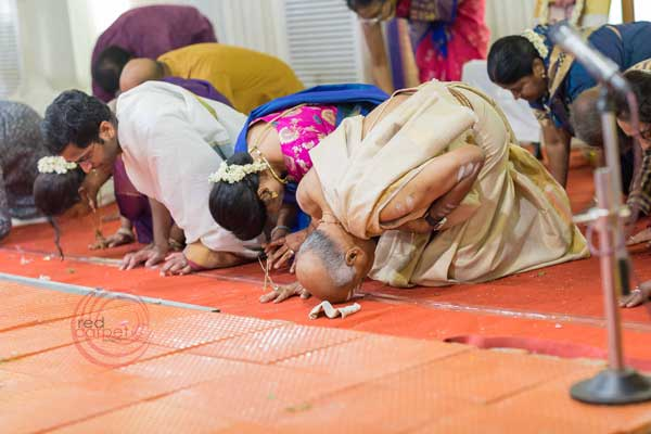 brahmin ritual bow to the guests -shashtipoorthi by Red Carpet Events at hotel indraprastha palakkad Coimbatore India Wedding Planning Gallery