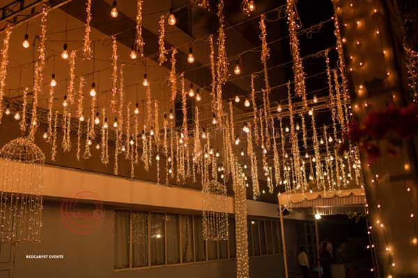 hanging mirchi string fairy lamp decor for entrance -Lighting by Red Carpet Events at kerala tamilnadu bengaluru India Wedding Planning Gallery