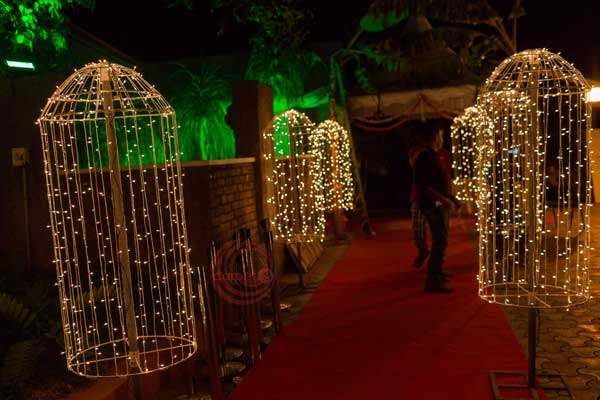 mirchi lights umbrella entrance decor -Lighting by Red Carpet Events at palakkad coimbatore kerala kochi India Wedding Planning Gallery