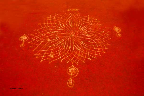 entrance kolam with rice powder on carpet -shashtipoorthi by Red Carpet Events at palakkad `kerala India Wedding Planning Gallery