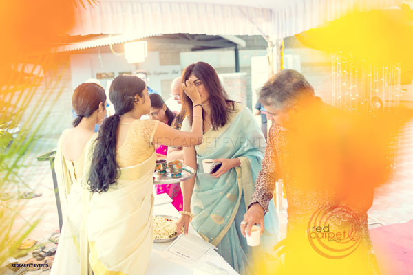 welcome girls apply sindoor for guests -shashtipoorthi by Red Carpet Events at hotel indra prastha palakkad kerala India Wedding Planning Gallery