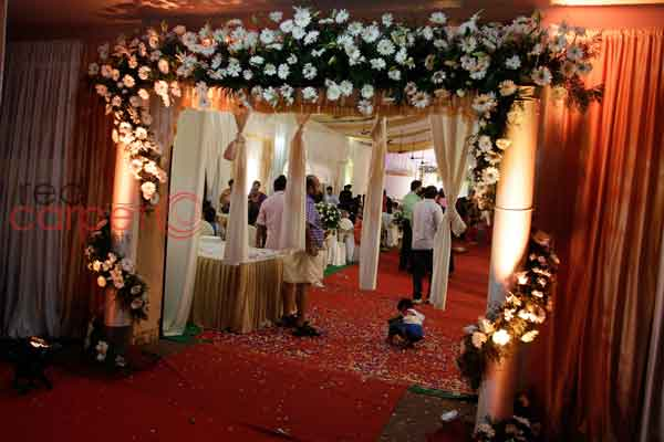 floral welcome arch -Christian wedding planning by Red Carpet Events at st.marys church kallooppara thiruvalla kerala India Wedding Planning Gallery