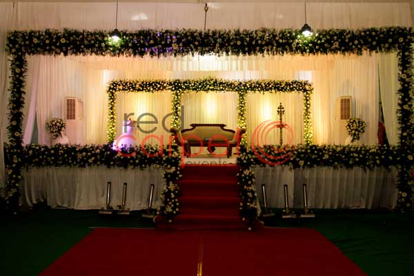 green & off white theme stage decor -Christian wedding planning by Red Carpet Events at pala thiruvalla kerala India Wedding Planning Gallery