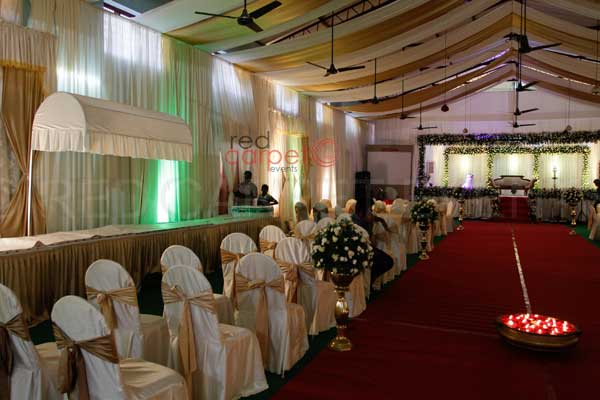 side curtaining decor -Christian wedding planning by Red Carpet Events at st.marys church parish hall kallooppara thiruvalla India Wedding Planning Gallery