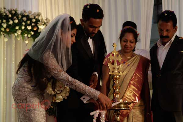 traditional lamp lighting by bride & groom -Christian wedding planning by Red Carpet Events at pala kottayam kerala India Wedding Planning Gallery