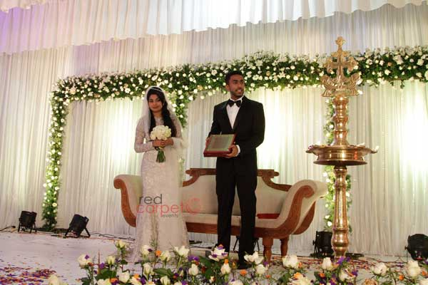 bride & groom at the  stage -Christian wedding planning by Red Carpet Events at st.marys orthodox church  hall kalloopara thiruvalla India Wedding Planning Gallery