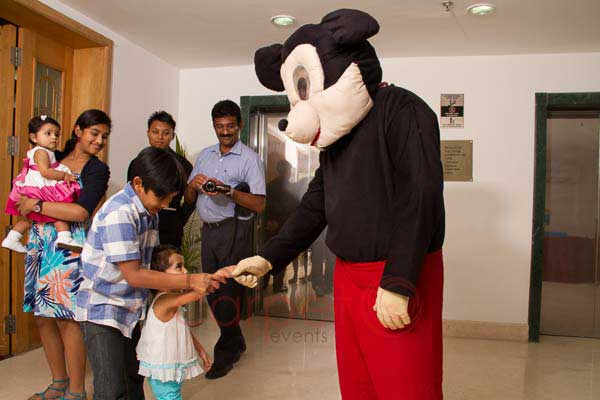 walking cartoon mickey mouse -Birthdays and Baptism planning by Red Carpet Events at hotel radisson blu kochi kerala India Wedding Planning Gallery