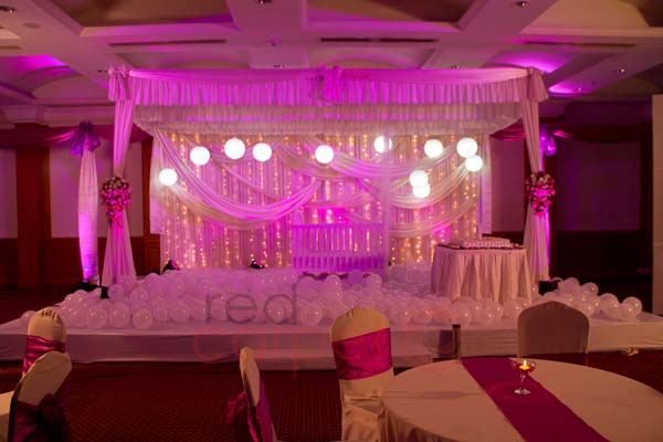 Hotel Radisson Blu facilities: Pink & white theme birthday  stage decor